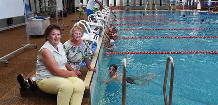WASA secretary Morna Hill and president Lois Clarke and swimmer-Mitchell Davis.